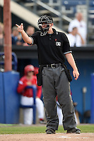 Umpire Jacob Metz makes a call during a game between the Jamestown Jammers and Batavia Muckdogs on July 7, 2014 at Dwyer Stadium in Batavia, New York.  Batavia defeated Jamestown 9-2.  (Mike Janes/Four Seam Images)