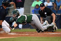 Daytona Tortugas catcher Chad Wallach (15) dives to tag Mark Payton (22) sliding safely into home on a wild pitch as umpire Derek Ivinski looks on to make the call during a game against the Tampa Yankees on April 24, 2015 at George M. Steinbrenner Field in Tampa, Florida.  Tampa defeated Daytona 12-7.  (Mike Janes/Four Seam Images)