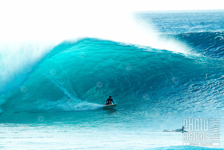 Surfing the Banzai Pipeline during the winter months at Ehukai Beach Park, north shore of the island of Oahu