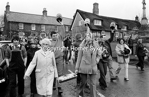 Bottle Kicking and Hare Pie Scrambling, Hallaton, Leicestershire, England 1973. Easter Monday.<br /> Men with Bottles, L-R Michael Garfield, Stephen Hines and David (Wacker) Wainright<br /> Carrying the Hare Pie, L-R Mrs Edith Payne along with her niece.