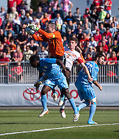 Scott Goodwin (1) of North Carolina takes control of the ball in front of Alex Shinsky (9) of Maryland during the game at the Maryland SoccerPlex in Germantown, MD. Maryland defeated North Carolina, 2-1,  to win the ACC men's soccer tournament.