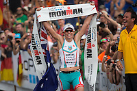 Mirinda Carfrae stands victorious at the 2013 Ironman World Championship in Kailua-Kona, Hawaii on October 12, 2013.