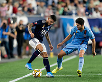 FOXBOROUGH, MA - SEPTEMBER 29: Gustavo Bao #7 of New England Revolution dribbles at midfield as Eric Miller #5 of New York City FC closes during a game between New York City FC and New England Revolution at Gillette Stadium on September 29, 2019 in Foxborough, Massachusetts.