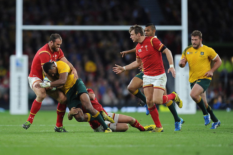 Tevita Kuridrani of Australia is tackled by Jamie Roberts of Wales during Match 35 of the Rugby World Cup 2015 between Australia and Wales - 10/10/2015 - Twickenham Stadium, London<br /> Mandatory Credit: Rob Munro/Stewart Communications