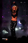 Britney Spears performs on stage at the MGM Grand Hotel, Saturday night in Las Vegas. The story is about the struggle that pop stars like Britney Spears have as they try to mature and get away from bubblegum kid-oriented pop. Her new concert tour is full of images that are comparatively dark, menacing, confusing - very different from the bright colors and smiles of her previous outings.