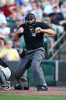 Home plate Johnny Conrad makes a call during a game at Frontier Field in Rochester, New York;  July 5, 2010..  Photo By Mike Janes/Four Seam Images