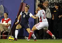 BOCA RATON, FL - DECEMBER 15, 2012: Kelley O'Hara (5) of the USA WNT pokes the ball away from Wu Haiyan (26) of China WNT during an international friendly match at FAU Stadium, in Boca Raton, Florida, on Saturday, December 15, 2012. USA won 4-1.