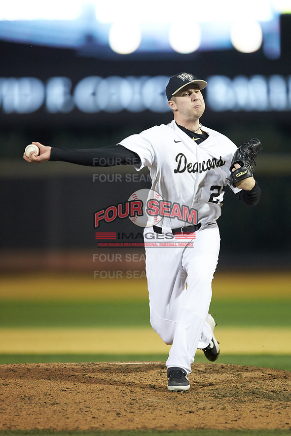 Wake Forest Demon Deacons relief pitcher Antonio Menendez (27) delivers a pitch to the plate against the Sacred Heart Pioneers at David F. Couch Ballpark on February 15, 2019 in  Winston-Salem, North Carolina.  The Demon Deacons defeated the Pioneers 14-1.  (Brian Westerholt/Four Seam Images)