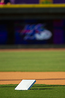 Second base waits to get put into place prior to the Carolina League game between the Lynchburg Hillcats and the Winston-Salem Dash at BB&T Ballpark on August 13, 2014 in Winston-Salem, North Carolina.  The Hillcats defeated the Dash 4-3.   (Brian Westerholt/Four Seam Images)