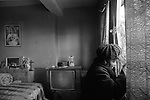Woman alone in Hoxton high rise flat London 1978.
