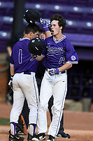 Center fielder Ben Anderson (17) of the Furman Paladins is congratulated by Simg Griffith as he crosses the plate after hitting a home run in game two of a doubleheader against the Harvard Crimson on Friday, March 16, 2018, at Latham Baseball Stadium on the Furman University campus in Greenville, South Carolina. Furman won, 7-6. (Tom Priddy/Four Seam Images)