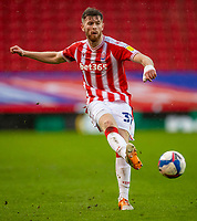 6th February 2021; Bet365 Stadium, Stoke, Staffordshire, England; English Football League Championship Football, Stoke City versus Reading; Nathan Collins of Stoke City crosses the ball