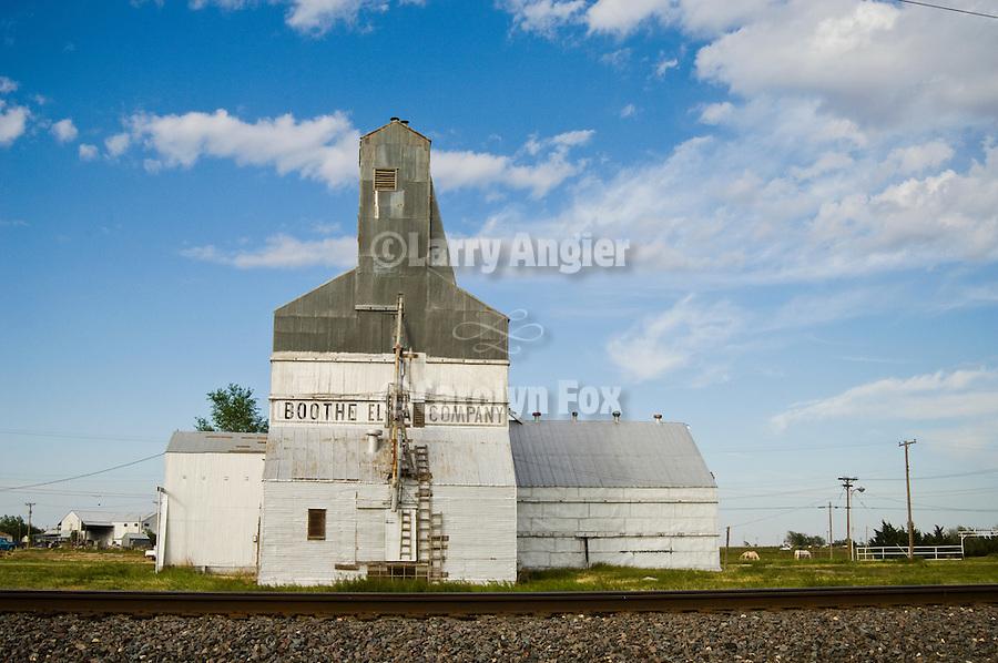 Grain elevators, rails, telephone lines and poles