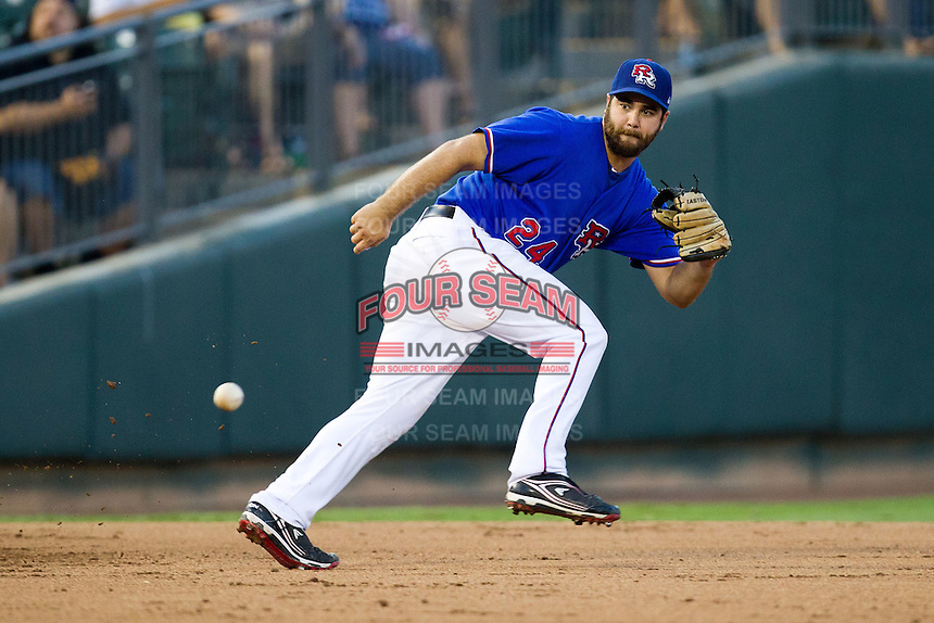 Round Rock Express third baseman Tommy Mendonca #24 fields a ground ball during the Pacific Coast League baseball game against the Oklahoma City RedHawks on June 15, 2012 at the Dell Diamond in Round Rock, Texas. The Express shutout the RedHawks 2-1. (Andrew Woolley/Four Seam Images).