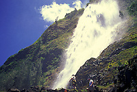 Visitors get a close look at Kaluahina Falls, reached from Waipio's black-sand beach.