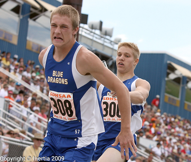 RAPID CITY, SD - MAY 30:  Andy Nolz of Garretson takes the baton from teammate Adam Halverson in the boys Class A 800 meter relay finals during the 2009 South Dakota State Track Meet Saturday in Rapid City. (Photo by Dave Eggen/Inertia)