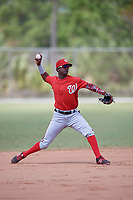 Washington Nationals Edwin Lora (10) throws to first base during practice before a minor league Spring Training game against the St. Louis Cardinals on March 27, 2017 at the Roger Dean Stadium Complex in Jupiter, Florida.  (Mike Janes/Four Seam Images)