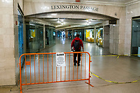 NEW YORK, NY - MAY 21:  A man crosses a closed area in Grand Central Terminal  during the outbreak of the COVID-19 pandemic on May 21, 2020 in New York City. The number of transit workers killed by the coronavirus is at least more than 123, the agency revealed Wednesday. (Photo by Eduardo MunozAlvarez/VIEWpress)