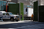 A man closes a gate to the Office of Chief Medical Examiner's temporary morgue in New York, the United States, Monday, April 6, 2020.  More than 10,000 people have died from COVID-19 in the U.S..  (Xinhua/Michael Nagle)