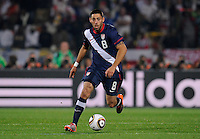 Clint Dempsey dribbles the ball. USA tied England 1-1 in the 2010 FIFA World Cup at Royal Bafokeng Stadium in Rustenburg, South Africa on June 12, 2010.
