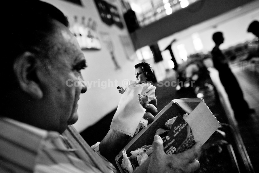 Pastor Hugo Alvarez examines an idol during the exorcism ritual at the Church of the Divine Saviour in Mexico City, Mexico, 31 May 2011. Exorcism is an ancient religious technique of evicting spirits, generally called demons or evil, from a person which is believed to be possessed. Although the formal catholic rite of exorcism is rarely seen and must be only conducted by a designated priest, there are many Christian pastors and preachers (known as 'exorcistas') performing exorcism and prayers of liberation. Using their strong charisma, special skills and religous formulas, they command the evil spirit to depart a victim's mind and body, usually invoking Jesus Christ or God to intervene in favour of a possessed person.