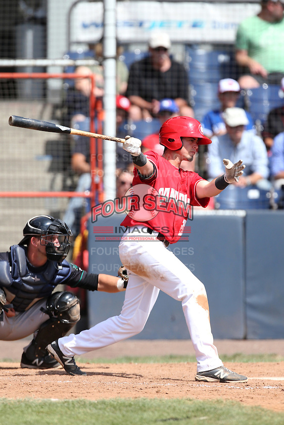 J.C. Cardenas (18) of the Vancouver Canadians bats during a game against the Eugene Emeralds at Nat Bailey Stadium on July 22, 2015 in Vancouver, British Columbia. Vancouver defeated Eugene, 4-2. (Larry Goren/Four Seam Images)