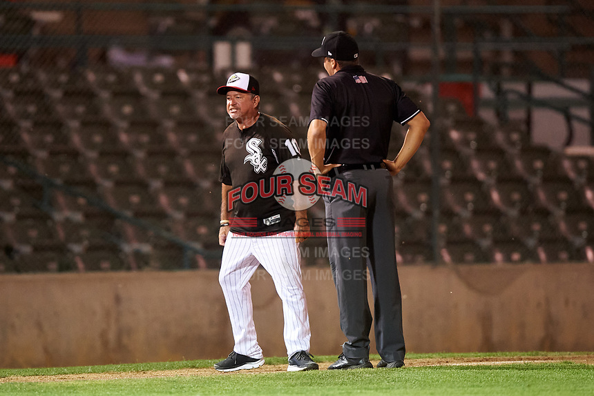 Great Falls Voyagers manager Tim Esmay (10) argues with umpire Casey James during a Pioneer League game against the Missoula Osprey at Centene Stadium at Legion Park on August 19, 2019 in Great Falls, Montana. Missoula defeated Great Falls 1-0 in the second game of a doubleheader. (Zachary Lucy/Four Seam Images)