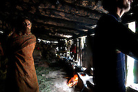 Bakarwal nomads inside their turf-roof summer house high in the mountains above Naranag, Gangabal Lake region of Kashmiri Himalayas, India.