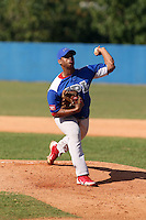 Elier Sanchez works out at the Dominican Republic air force base in front of 100+ Major League Baseball scouts prior to being declared eligible to sign since defecting from his native Cuba in Santo Domingo, Dominican Republic on February 11, 2015 (Bill Mitchell)