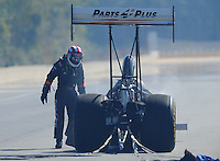 Mar. 13, 2011; Gainesville, FL, USA; NHRA top fuel dragster driver Clay Millican looks over the damage during the Gatornationals at Gainesville Raceway. Mandatory Credit: Mark J. Rebilas-