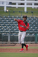 Julio Carreras (4) of the Fresno Grizzlies throws to first base during a game against the Inland Empire 66ers at San Manuel Stadium on May 25, 2021 in San Bernardino, California. (Larry Goren/Four Seam Images)