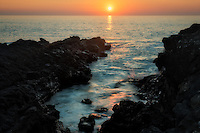 Sunset at small inlet near Hapuna Beach, Hawaii Island. The Big Island
