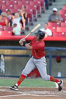 Rudy Flores #11 of the Visalia Rawhide bats against the High Desert Mavericks at Heritage Field on July 19, 2014 in Adelanto, California. Visalia defeated High Desert, 10-9. (Larry Goren/Four Seam Images)