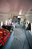 Interior of a S61 Sikorsky air sea search and rescue helicopter showing stretcher, medical kit and in the background, the cockpit...© SHOUT. THIS PICTURE MUST ONLY BE USED TO ILLUSTRATE THE EMERGENCY SERVICES IN A POSITIVE MANNER. CONTACT JOHN CALLAN. Exact date unknown.john@shoutpictures.com.www.shoutpictures.com.....