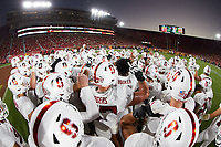 LOS ANGELES, CA - SEPTEMBER 11: The Stanford Cardinal huddle before a game between University of Southern California and Stanford Football at Los Angeles Memorial Coliseum on September 11, 2021 in Los Angeles, California.