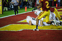 LOS ANGELES, CA - October 29, 2011:  AJ Tarpley recovers a USC fumble during the third overtime period in Stanford's Pac-12 game against the USC Trojans.  The fumble recovery sealed Stanford's 56 -48 victory and extended its winning streak to 16 games.