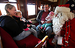 Santa talks with Laura Shuft, Heaven Schuft, 4, David Potts, and Meredith Schuft, 1, on the Santa Train at the Nevada State Railroad Museum in Carson City, Nev., on Sunday, Dec. 1, 2013. (Cathleen Allison/Las Vegas Review-Journal)