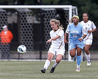 Boston College midfielder Kate McCarthy (21) clears the ball.   University of North Carolina (blue) defeated Boston College (white), 1-0, at Newton Campus Field, on October 13, 2013.