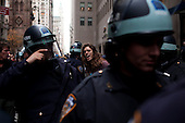 """New York, New York<br /> November 17, 2011<br /> <br /> """"Occupy Wall Street"""" protesters mark the movement's two-month milestone by marching from Zuccotti Park, in mass, to various access streets surrounding the New York Stock Exchange, which the police had barricaded off. Yet instead of the police keeping protesters out, protesters locked down those entrances to Wall Street and the New York Stock Exchange creating havoc as the police made more then 240 arrests to try and keep the streets open to normal traffic.<br /> <br /> An anti-Wall Street protester is arrested on Broadway just in front of a Chase Manhattan entrance."""