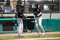 "Visalia Rawhide right fielder Ramon Hernandez (16) celebrates with an ""invisible football handoff"" from manager Jeff Bajenaru (11) after hitting a two-run home run during a California League game against the Stockton Ports at Visalia Recreation Ballpark on May 9, 2018 in Visalia, California. Stockton defeated Visalia 4-2. (Zachary Lucy/Four Seam Images)"