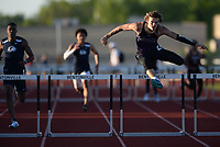 Sam Hurley of Fayetteville clears the final hurdle Friday, April 30, 2021, to win the 300-meter hurdles the during the 6A-West Conference Track and Field Meet at the Tiger Athletic Complex in Bentonville. Visit nwaonline.com/210501Daily/ for today's photo gallery. <br /> (NWA Democrat-Gazette/Andy Shupe)