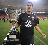 DC United forward Jaime Moreno (99) holds the Atlantic Cup that was earned after defeating the New York Red Bulls.  DC United defeated the New York Red Bulls 2-0, at RFK Stadium ,Thursday June 4, 2009.