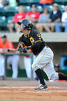 Third baseman Edgardo Munoz (38) of the Bristol Pirates bats in a game against the Greeneville Astros on Friday, July 25, 2014, at Pioneer Park in Greeneville, Tennessee. Greeneville won, 9-4. (Tom Priddy/Four Seam Images)