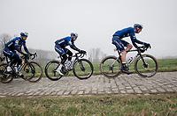 "Tim Declercq ""El tractor"" (BEL/Deceuninck - Quick Step)  leading the peloton over the Haaghoek cobbles<br /> <br /> 76th Omloop Het Nieuwsblad 2021<br /> ME(1.UWT)<br /> 1 day race from Ghent to Ninove (BEL): 200km<br /> <br /> ©kramon"