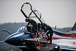 Pilots climb into a People's Liberation Army Air Force (PLAAF) Chengdu J-10 jet fighter, manufactured by Chengdu Aerospace Corp., a unit of Aviation Industry Corp. of China (AVIC), before an aerobatics display at the China International Aviation & Aerospace Exhibition (Airshow China 2016) at China International Aviation Exhibition Center on 02 November 2016, in Zhuhai, China. Photo by Marcio Machado / Power Sport Images