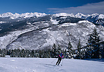 Downhill skier on slopes near the Gore Range, Vail, Colorado