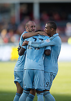 18 August 2012: Sporting KC forward Kei Kamara #23 celebrates his goal with Sporting KC defender Aurelien Collin #78 and Sporting KC forward Teal Bunbury #9 during an MLS game between Sporting Kansas City and Toronto FC at BMO Field in Toronto, Ontario Canada..Sporting Kansas City won 1-0.