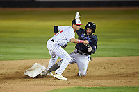 Great Falls Voyagers second baseman Kelvin Maldonado (1) tags Jose Reyes (20) during a Pioneer League game against the Missoula Osprey at Centene Stadium at Legion Park on August 19, 2019 in Great Falls, Montana. Missoula defeated Great Falls 1-0 in the second game of a doubleheader. (Zachary Lucy/Four Seam Images)