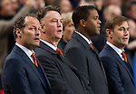 Coaches Danny Blind (L), Louis van Gaal ( 2ndL) Patrick Kluivert ( 2nd R) and Frans Hoek (R) sing the National anthem prior to their 2014 World Cup qualifying soccer match against Estonia in Amsterdam March 22, 2013. photo: Michael Kooren (NETHERLANDS)