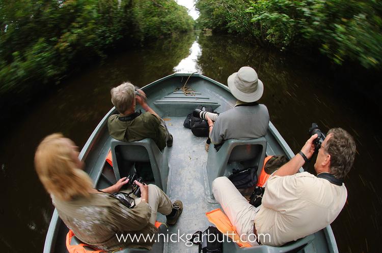 Tourists / photographers wildlife watching along Menanggol River, Kinabatanagan, Sabah, Borneo.
